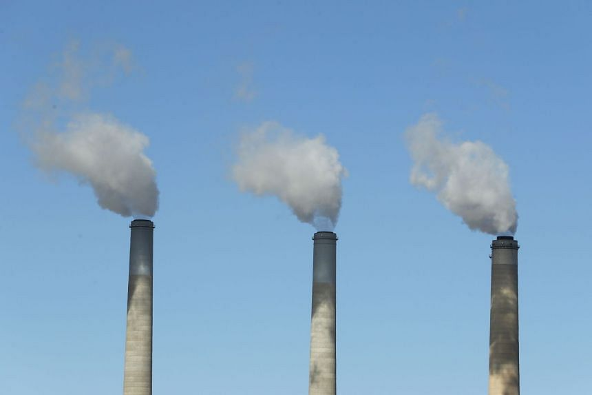 Emissions rise from the smokestacks of a coal-fired power plant on Oct 9, 2017, in Castle Dale, Utah.