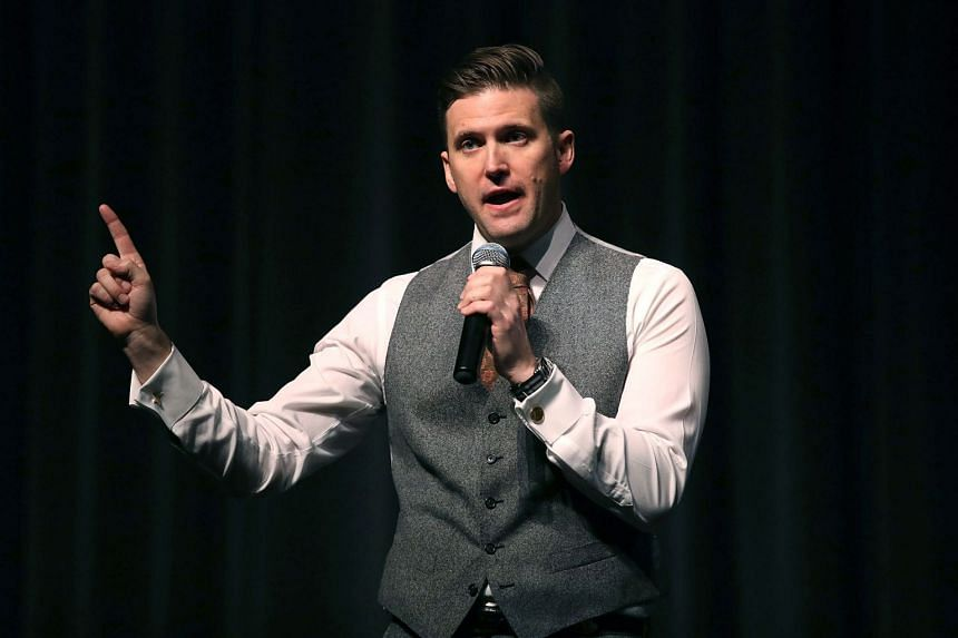 """White nationalist Richard Spencer, who popularised the term """"alt-right"""", speaks at the Curtis M. Phillips Centre for the Performing Arts."""