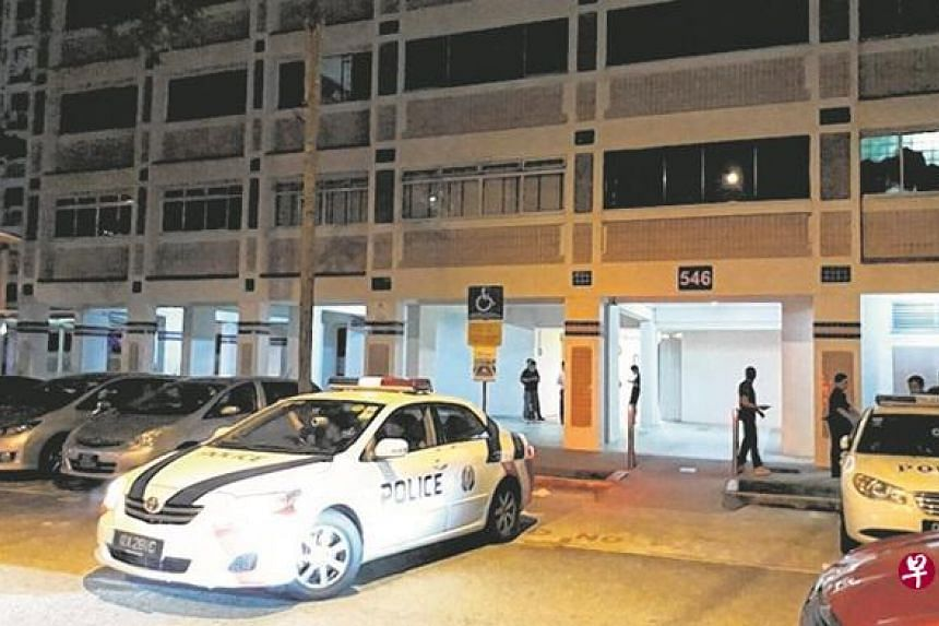 More than 10 policemen were seen at the void deck, some with riot shields.