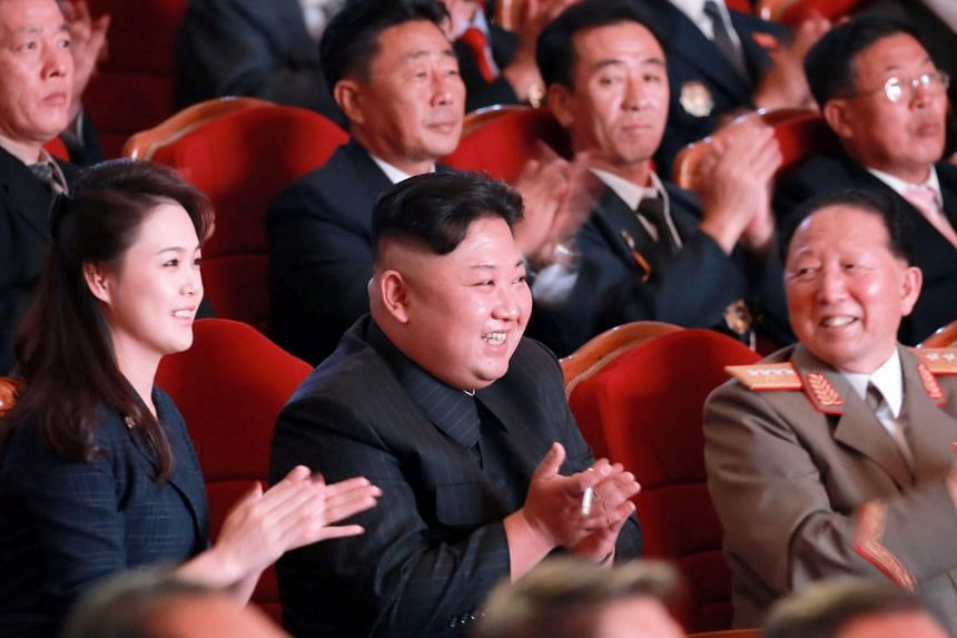 North Korean leader Kim Jong-un (centre) attends an event to celebrate a nuclear test, Sept 3, 2017.