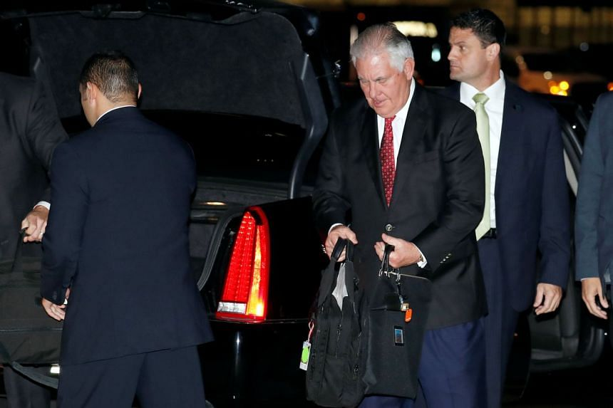 Tillerson gathers his belongings to board his plane, at Andrews Air Force Base in the US.