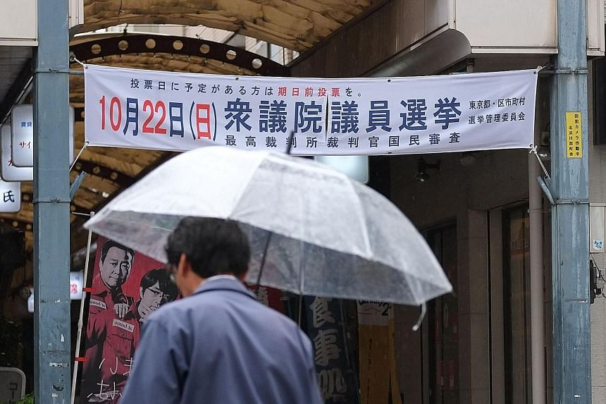 A banner in Tokyo to encourage participation in the election. Turnout has declined to below 60 per cent in Japan's last two general elections.