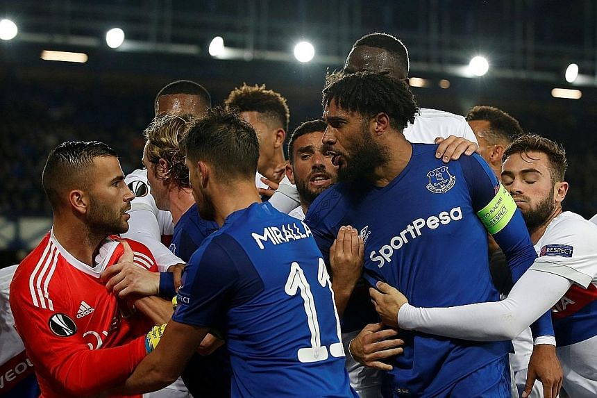 Everton captain Ashley Williams confronting Lyon goalkeeper Anthony Lopes, which led to the melee between both sides. Uefa has charged the home side over the unsavoury incident in which several home fans also got involved.