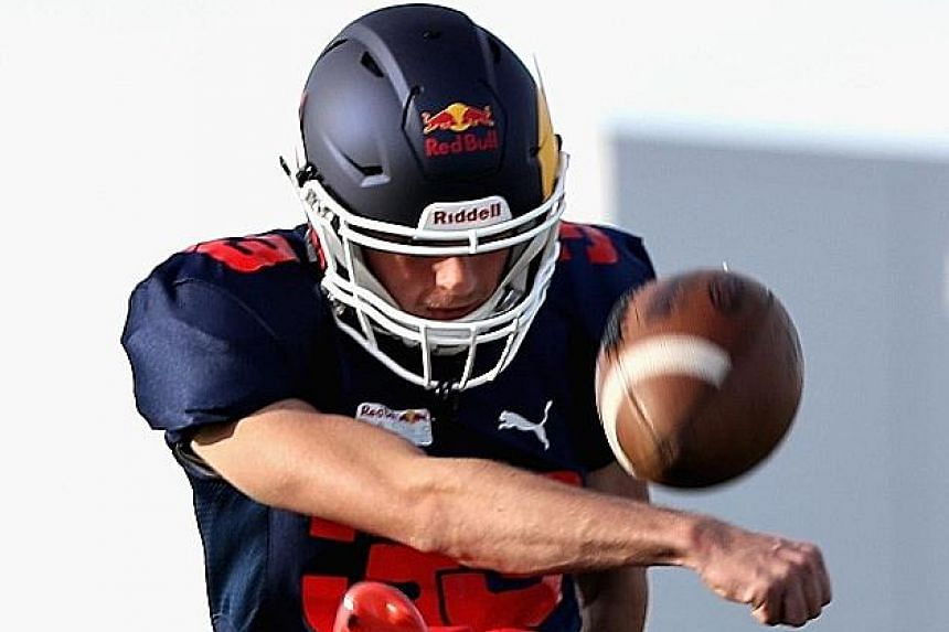 Red Bull Formula One drivers Daniel Ricciardo (left) and Max Verstappen swopping their racing suits for American football gear before the United States Grand Prix. Training with the Del Valle Cardinals High School team on Thursday, Verstappen, who be
