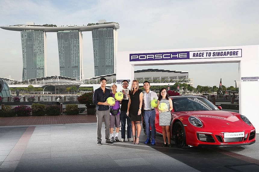 From left: Straits Times readers Davy Sanh, Bernard Lau, Justin Tan, Sean Long and Natalie Ow won the chance to meet world No. 1 Simona Halep, the top player of this year's Porsche Race to Singapore, at a handover ceremony for the 911 GTS yesterday.