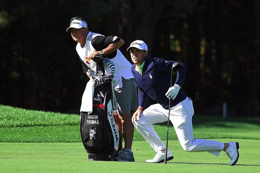 Above: American Justin Thomas and his caddie watching his second shot on the third hole during the second round of the CJ Cup at Nine Bridges in Jeju Island yesterday. Left: Luke List, ranked 138th in the world, is the surprise halfway leader on 135.