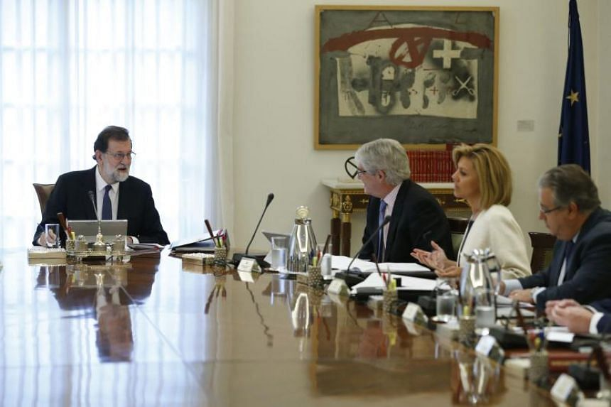 Spanish Prime Minister Mariano Rajoy (L) at a crisis cabinet meeting at the Moncloa Palace on Oct 21, 2017 in Madrid.