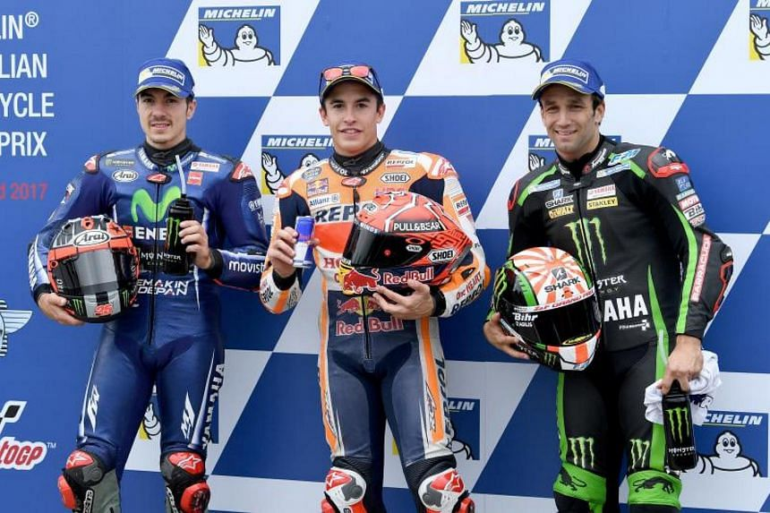 (left-right) Spanish Moto GP riders Maverick Vinales from Movistar Yamaha team, Marc Marquez from Repsol Honda team, and Frenchman Johann Zarco from the Monster Yamaha Tech 3, pose for photographers after finishing in the top 3 positions after quali