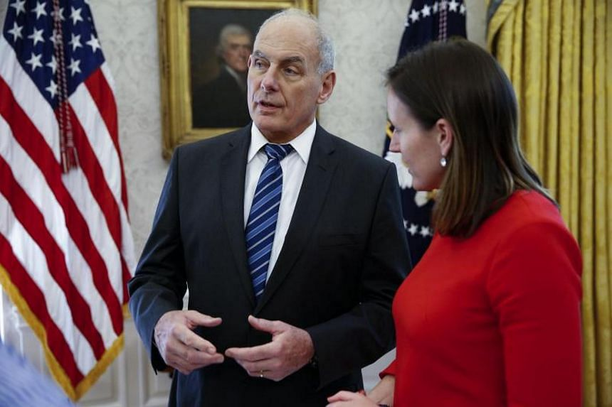 White House Chief of Staff John Kelly (left) talks with White House Deputy Press Secretary Lindsay Walters in the White House in Washington on Oct 20, 2017.