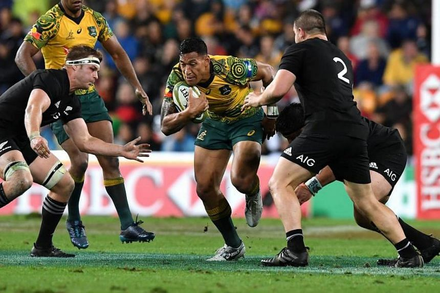 Israel Folau (center) of the Wallabies in action during the third Bledisloe Cup match between the Australian Wallabies and the New Zealand All Blacks at Suncorp Stadium in Brisbane on Oct 21, 2017.