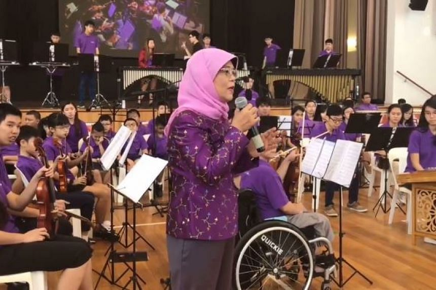 President Halimah Yacob enjoyed a preview of an upcoming performance of the the Purple Symphony on Saturday (Oct 21).