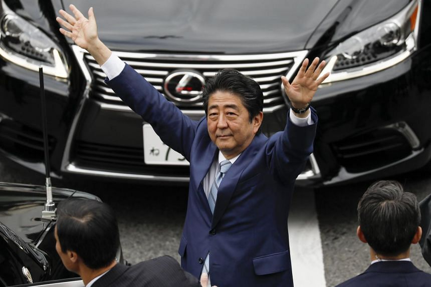 Japanese Prime Minister Shinzo Abe waves to voters after delivering a campaign speech during the Lower House election campaign in Fujisawa, Kanazawa Prefecture, south of Tokyo Japan, on Oct 20, 2017.
