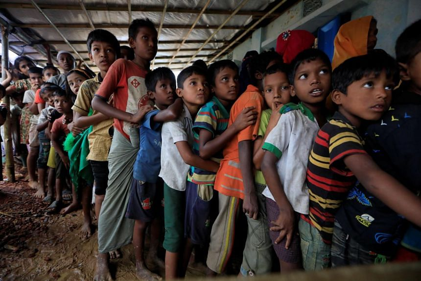 Rohingya refugees line up at a registration center in Kutupalong refugees camp in Cox's Bazar, Bangladesh on Oct 20, 2017.