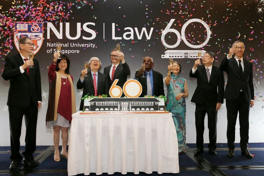 At the cake cutting and toast are (from left) Prof Tan Lee Meng, Dr Thio Su Mien, Prof Tommy Koh, Prof Simon Chesterman, Prof S Jayakumar, Prof Tan Sook Yee, Prof Chin Tet Yung and Prof Tan Cheng Han.