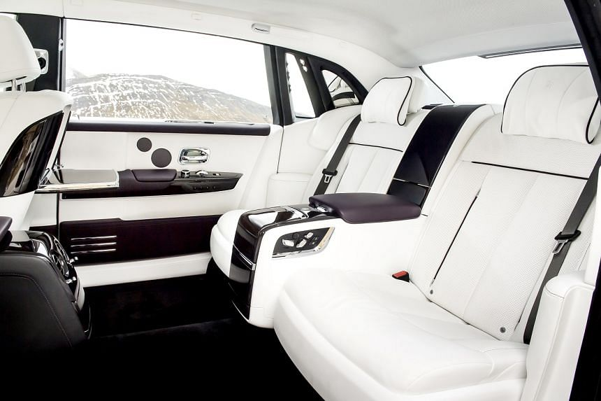 The regal looking Rolls-Royce Phantom VIII comes with an equally luxurious space for passengers to stretch out in the back (above).