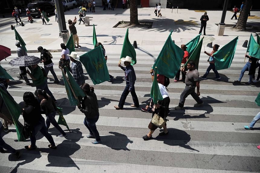 Farmers marching in Mexico City on Aug 8 as part of nationwide protests against the North American Free Trade Agreement. US President Donald Trump has not (yet) followed through on tougher promises, to impose 35 per cent to 40 per cent tariffs on imp