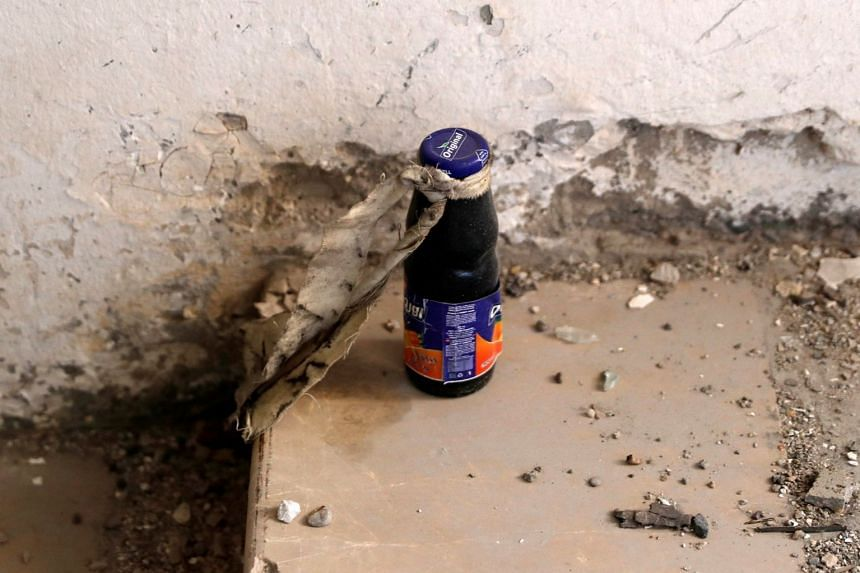 A juice bottle containing explosives found near the bunker of ISIS militants in a stadium in Raqqa, Syria, on Wednesday.