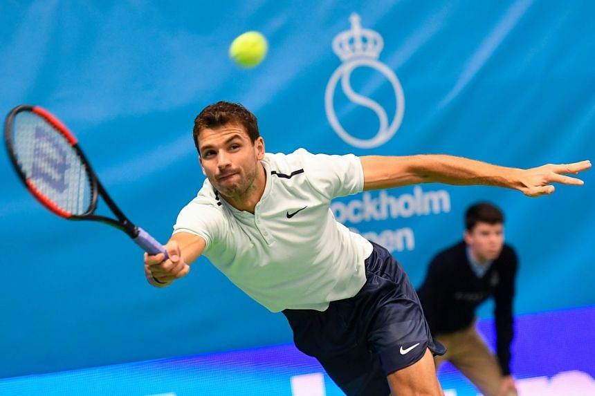 Dimitrov returns the ball to Germany's Mischa Zverev.