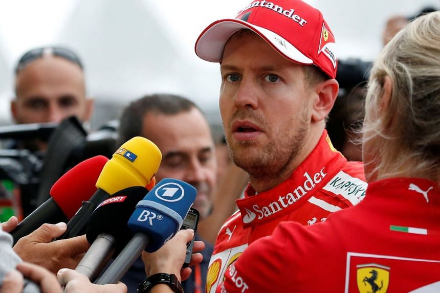 Ferrari's Sebastian Vettel of Germany speaks to media after qualifying at the Japanese Grand Prix 2017, on Oct 7, 2017.