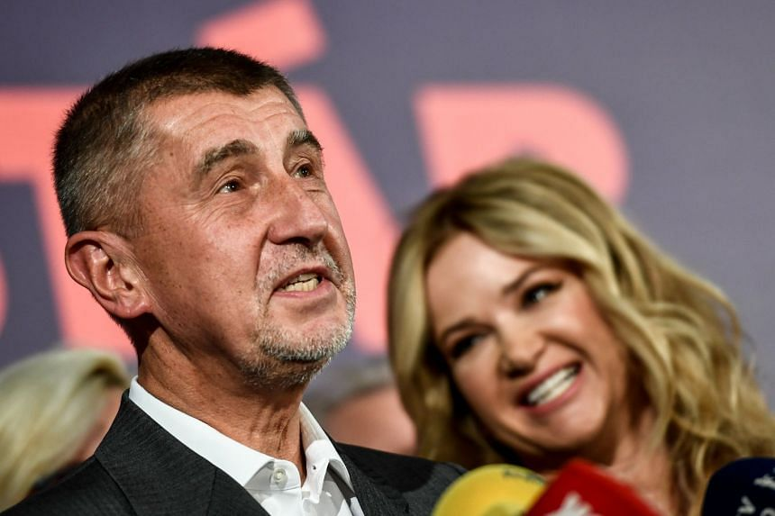 Andrej Babis speaks next to his wife Monika after initial poll results.