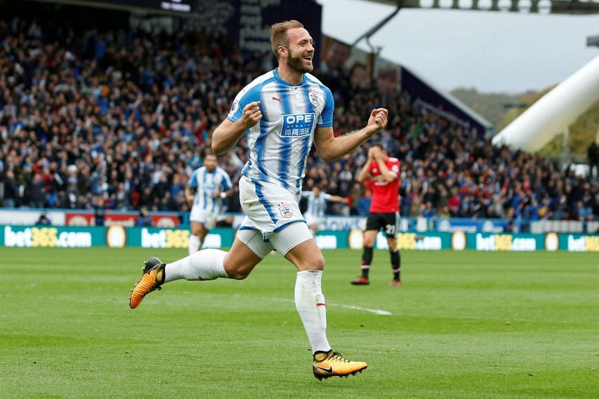 Huddersfield Town's Laurent Depoitre celebrates scoring their second goal.
