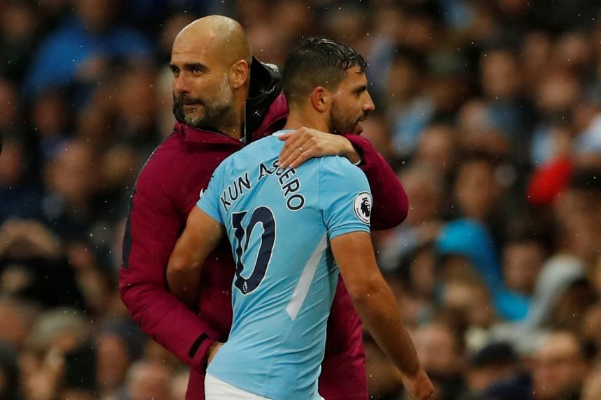 Pep Guardiula hugs City's Sergio Aguero as he is substituted off.