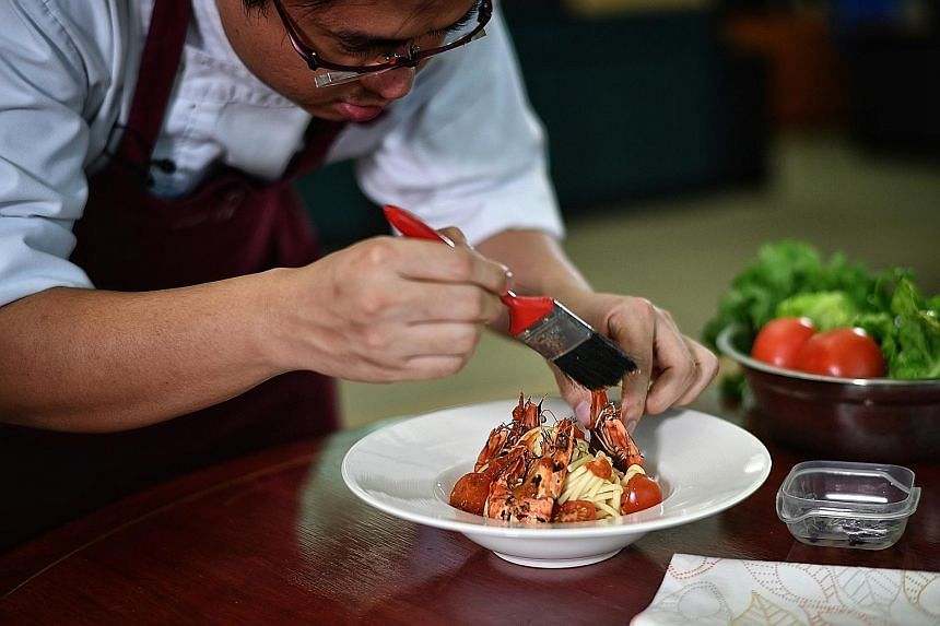 Mr Tan Chun Rong, who made the switch from food photography about a year ago, styling a plate of handmade udon at home.