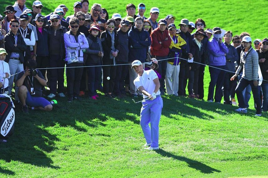 American Justin Thomas chipping onto the third green during the third round of the CJ Cup on Jeju Island yesterday.