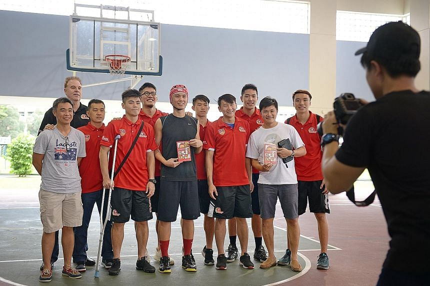 Former national basketballer Lim Wai Sian (centre, wearing rugby cap) launched his first book titled Rebound: LaoLao's Guide to Giving Up yesterday at his alma mater, the Presbyterian High School. He was joined by his former team-mates and coaches fr