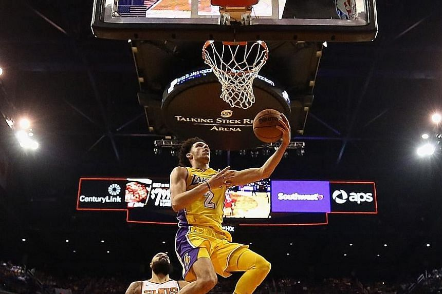 Los Angeles Lakers point guard Lonzo Ball made 12 of his 27 shots against Phoenix and was decisive after the break, as he scored 20 of his game-high 29 points to help his team record their first win of the season.