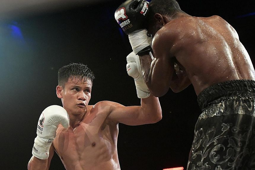 "Muhamad Ridhwan on the attack as Nataneal Sebastian shields himself during the super-featherweight bout on Friday night. It was the first time that the self-styled ""Chosen Wan"" had been taken to 12 rounds in his career."