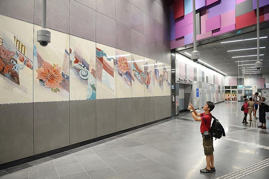 Below and right: Commuters at the Tampines East station. Centre: Production technician E.L. Ong taking photos of the art pieces inside Bendemeer station. Far right: Fort Canning station, whose green colour scheme reflects the nearby landscape.