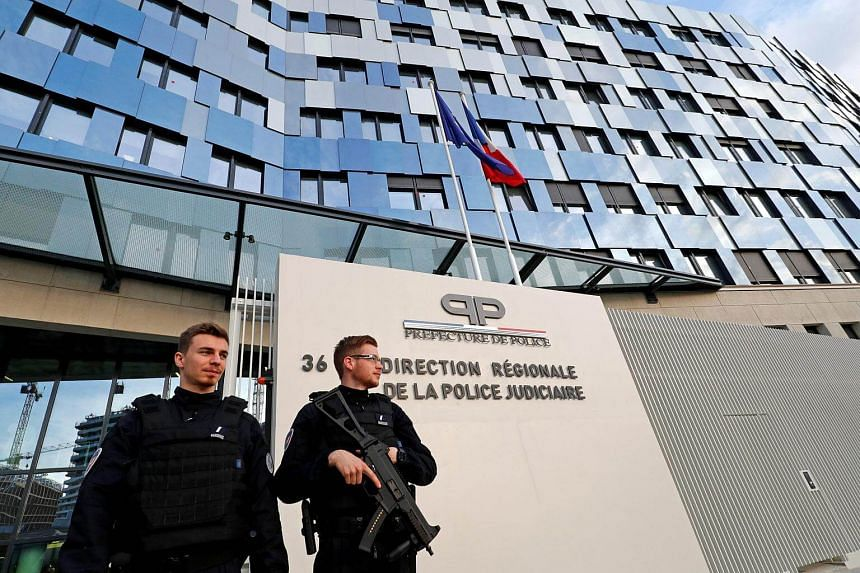 French policemen stand in front of the entrance of the new headquarters of the Direction Regionale de Police Judiciaire de Paris (DRPJ Paris), the criminal investigation division of the Police nationale.