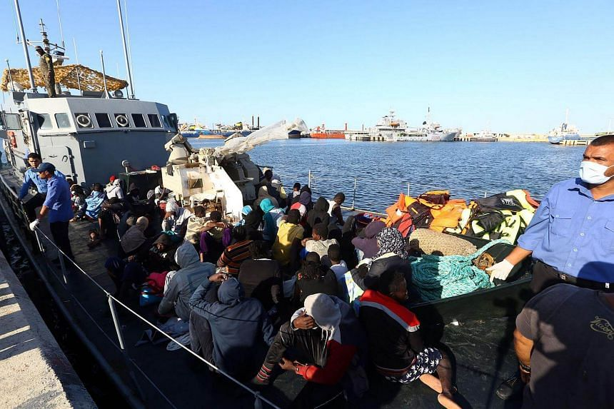 African migrants arrive at a naval base in the Libyan capital Tripoli, after they were rescued from a rubber boat by the coastguards off the Libyan coast of Sabratha.