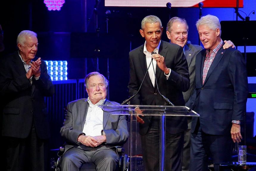 Five former US presidents, Jimmy Carter, George H.W. Bush, Barack Obama, George W. Bush and Bill Clinton, speak during a concert at Texas A&M University benefiting hurricane relief efforts in College Station, Texas.