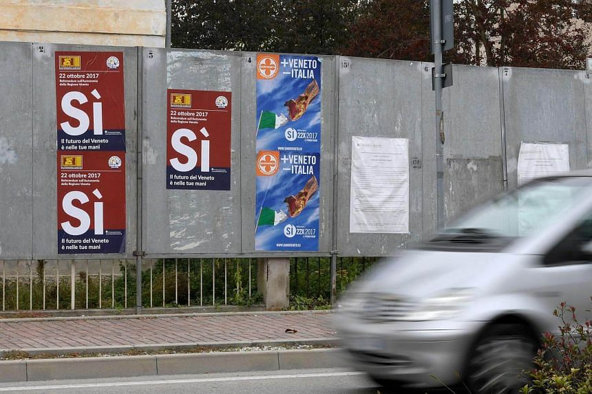 Posters announcing a referendum in Italy's northern-east region of Veneto to request more autonomy from Roma's central government.