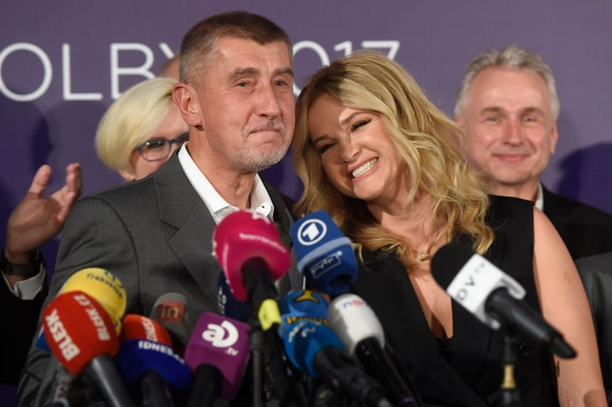 Czech billionaire Andrej Babis and his wife Monika smile at ANO headquarters in Prague, Oct 21, 2017.