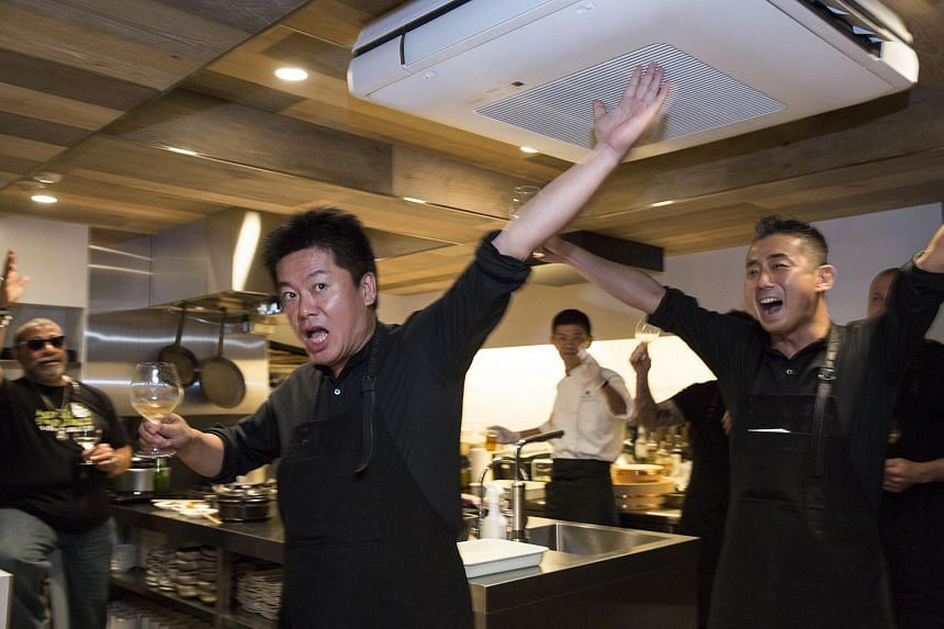 Wagyumafia Co-founders Takafumi Horie (left) and Hisato Hamada raising their glasses for a toast during a private party at a restaurant operated by Wagyumafia in Tokyo on Sept 28, 2017.