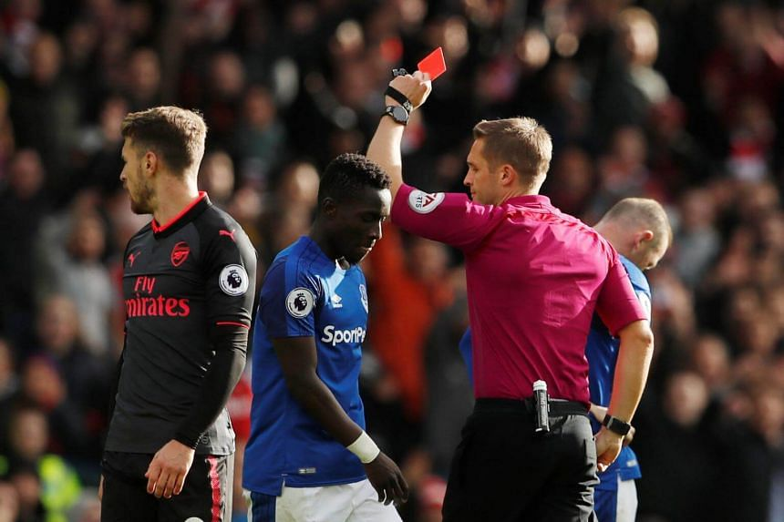 Everton's Idrissa Gueye is shown a red card by referee Craig Pawson after receiving a second yellow card during the Premier League on Oct 22, 2017.