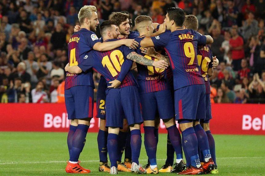 Barcelona's Gerard Deulofeu celebrates with his team mates after scoring a goal during the Spanish Primera Liga on Oct 21, 2017