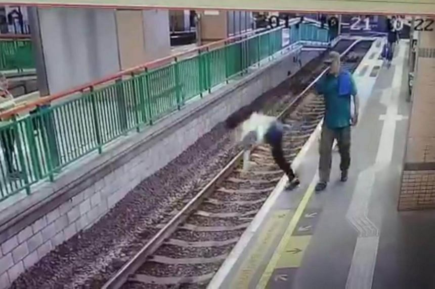 A 56-year-old man was arrested in Hong Kong on Oct 21, after allegedly shoving a cleaner onto the train tracks.