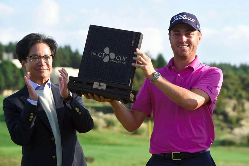 Justin Thomas (right) and Lee Jay-Hyun, chairman of the South Korean food and entertainment giant CJ Group, at CJ Cup at Nine Bridges in Jeju Island on Oct 22, 2017.