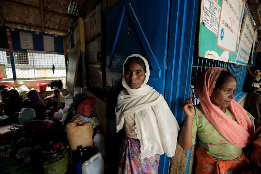 Rohingya refugees who crossed the border from Myanmar this week take shelter at a school in Kutupalong refugee camp near Cox's Bazar, Bangladesh on Oct 22, 2017.