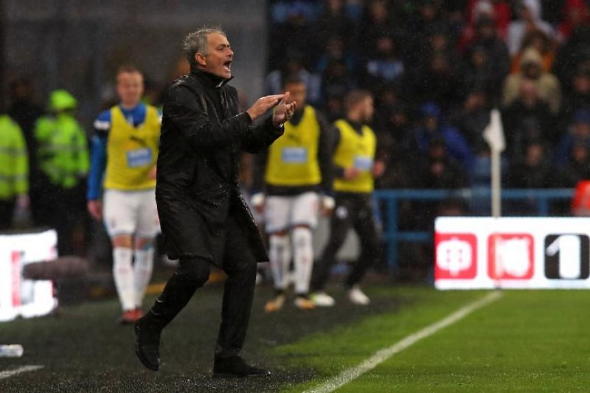 Jose Mourinho gestures on the touchline during the English Premier League football match between Huddersfield Town and Manchester United.