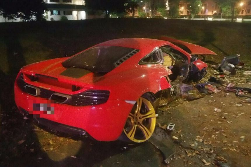 The wreckage of the red McLaren sports car seen after the collision.