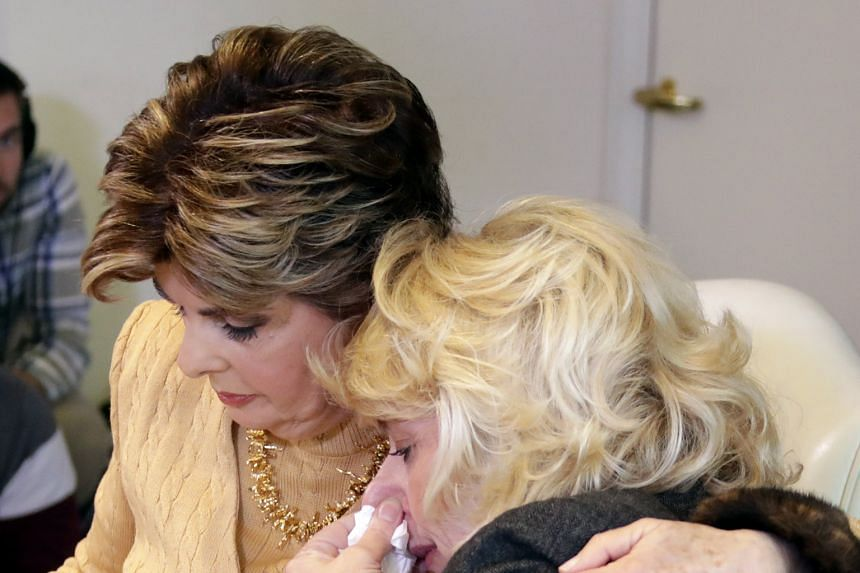 Former actress Heather Kerr (at right) being hugged by attorney Gloria Allred as she cried while reading a statement during a press conference on Friday where she accused Harvey Weinstein of sexual assault.