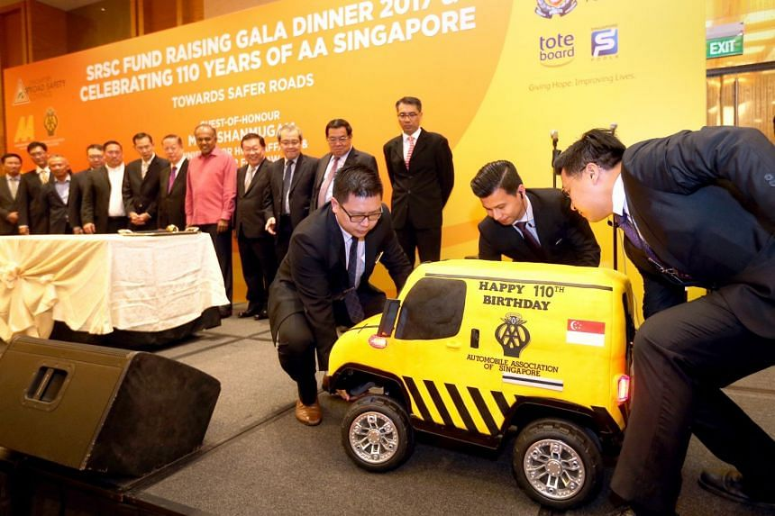 A van-cake was jointly cut by Singapore Road Safety Council members and Mr Shanmugam.