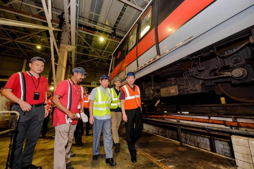Transport Minister Khaw Boon Wan and SMRT's new chairman Seah Moon Ming at Bishan Depot on Aug 28, 2017.