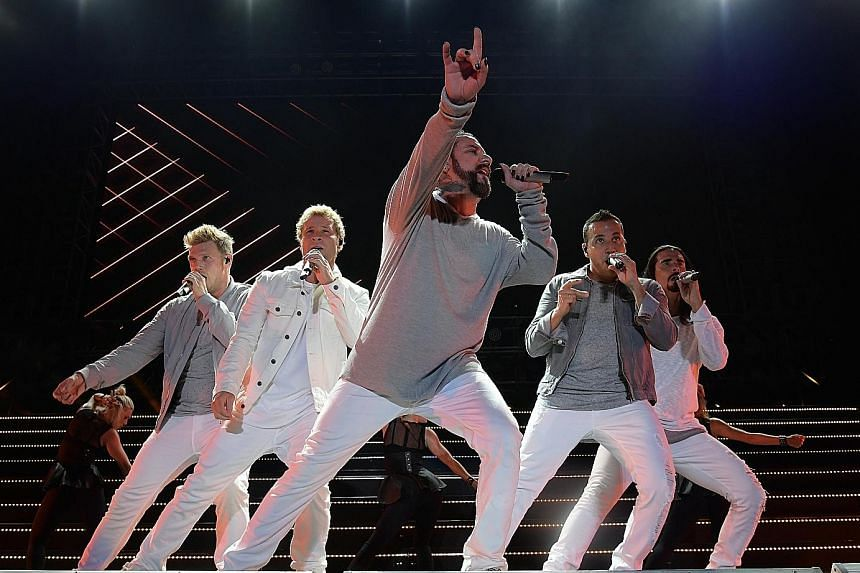 Backstreet Boys (comprising from left, Nick Carter, Brian Littrell, AJ McLean, Howie Dorough and Kevin Richardson) charmed fans with familiar songs and dance routines.