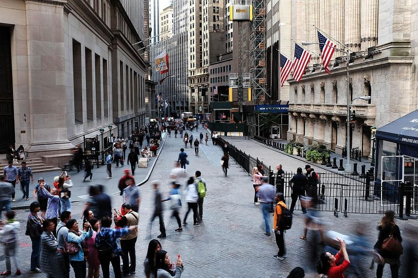 The New York Stock Exchange in Manhattan. Buoyed by resurgent global trade and economic growth, Wall Street is now in the second longest bull market in US history, with the Dow up 27 per cent in the past year and 250 per cent since it bottomed out in